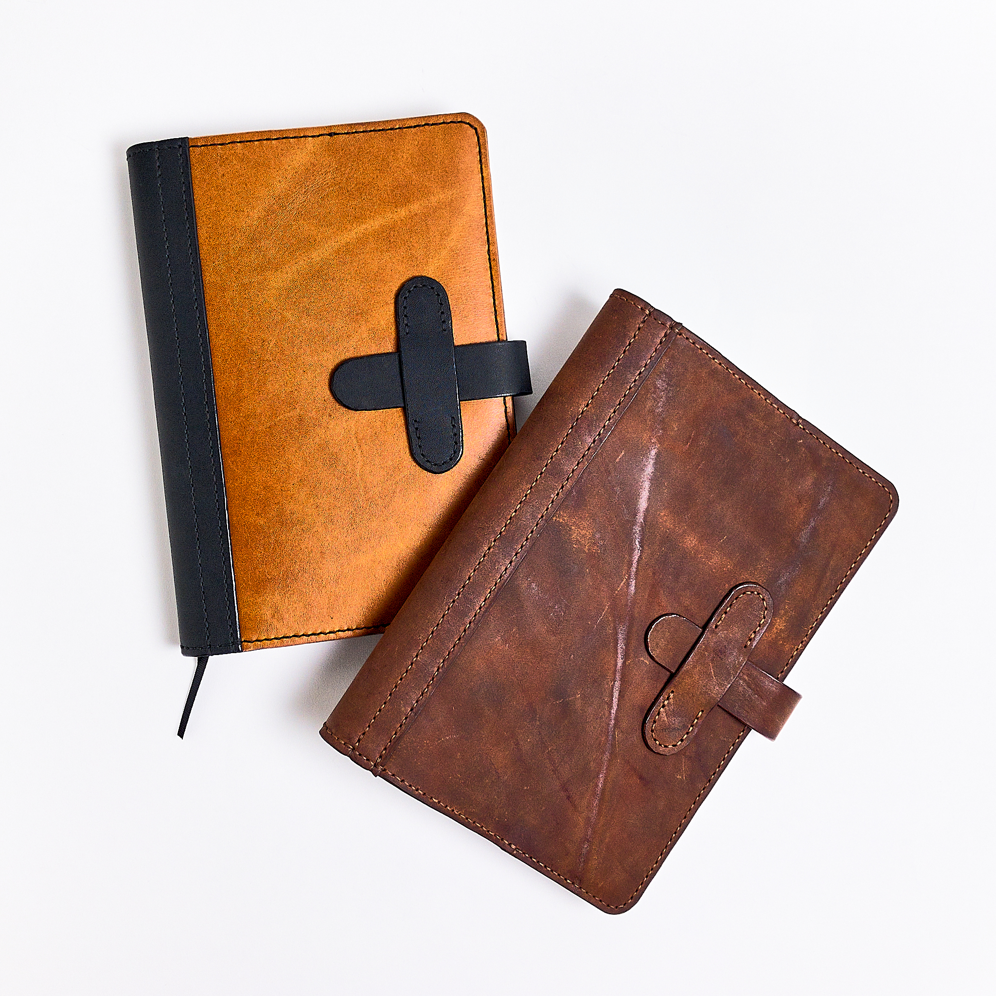 Two hand-stitched leather journal covers made by Bob Gilmour, Australia - Gilmour Design